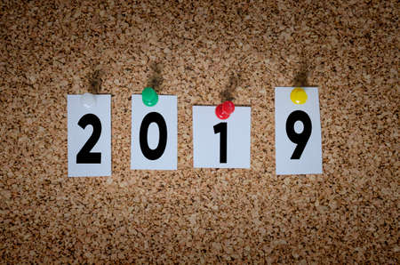 2019 note pinned to a cork board. New Year 2019 concept. Фото со стока