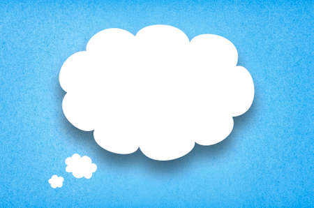 White paper thought bubble. White paper cloud with blue cardboard background.