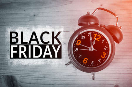 Black Friday text with old analog clock. Black Friday sale concept.