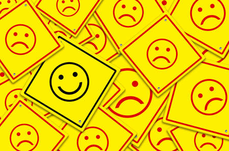 Happy and unhappy concept. Background of yellow road signs. Happy road sign is among sad road signs. Stock Photo
