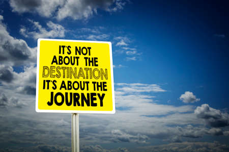 It`s about the Journey road sign with the cloudy sky background. Travel, adventure, road trip motivational quote. Stock Photo
