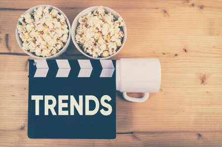 Trends concept with movie clapper board, top view. Stock Photo