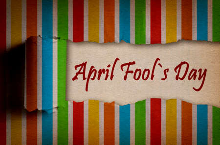 April Fool s Day written under torn colorful paper