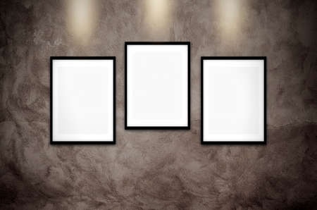 Gallery interior with empty frames on concrete wall Stock Photo