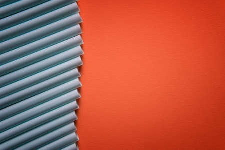 Plastic straws in a row, isolated on orange background. Minimalism concept. Pop art style.