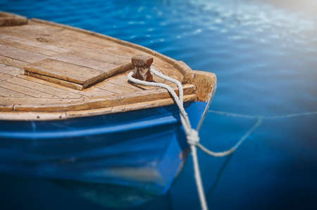 A docked old blue fishing boat