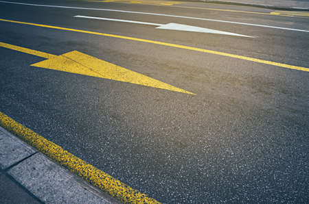 Yellow and white arrow on the road. City traffic. Reklamní fotografie