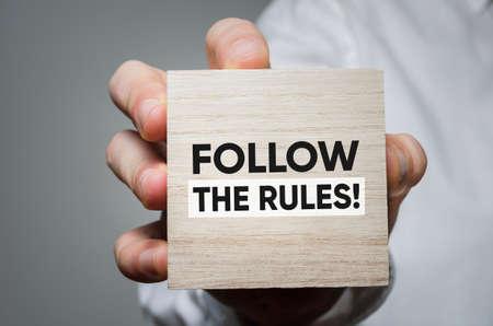 Follow the rules! Business development concept. Фото со стока