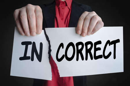 Businessman tearing up a paper sign, Incorrect become Correct. Фото со стока