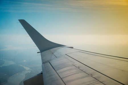 Airplane takeoff. Look through aircraft window during flight. Фото со стока