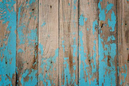 Old shabby light blue wood texture with peeled paint.