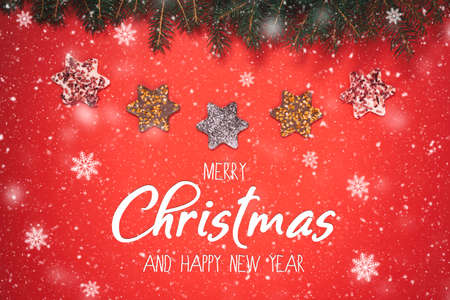 Merry Christmas and Happy New Year - Christmas background with festive decoration and text  Фото со стока