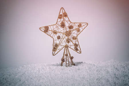 Gold Christmas star. Christmas and New Year decoration. Merry Christmas and Happy New Year Card Фото со стока