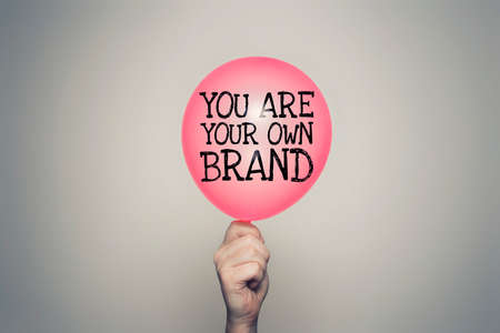 You are your own brand balloon in hand Фото со стока