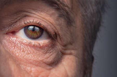 Close-up view on the eye of senior man. Фото со стока