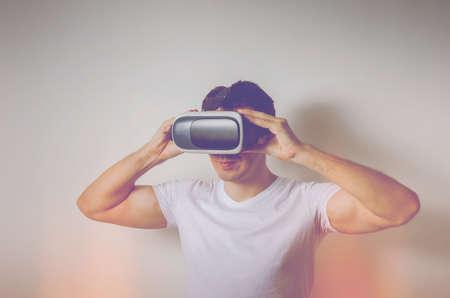 Man using virtual reality headset. Exploring virtual reality concept. Фото со стока