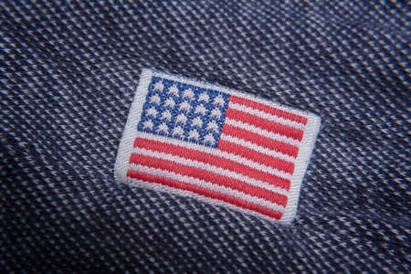 Buy American. USA flag clothing label close up.