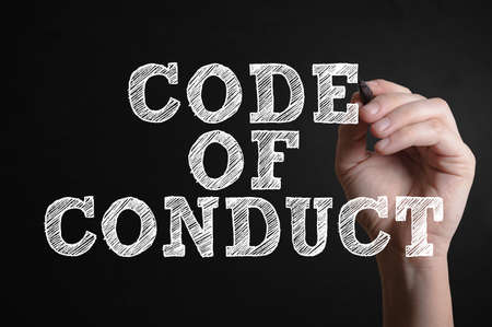 Hand writing Code of conduct on a virtual screen