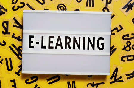 E-learning concept with letters and light box. E-learning, webinar, training, business and internet technology concept. Stock Photo