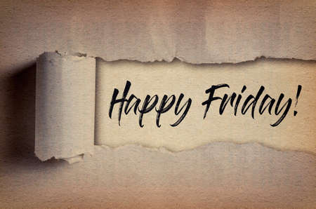 Happy Friday! written under torn paper. Motivational quote about Friday and weekend. Stock Photo