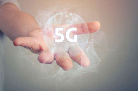 5G network wireless systems and internet of things with open palm hand gesture of male hand on light background