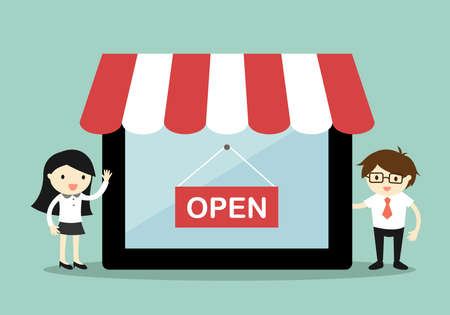 Business concept, Business woman and businessman standing beside the online shop in tablet, online shopping concept.