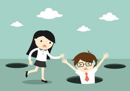 concepto de negocio, caída del hombre de negocios en el agujero, pero la mujer de negocios tratando de ayudarlo.