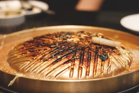 Empty barbecue pan at barbecue restaurant. Stock Photo