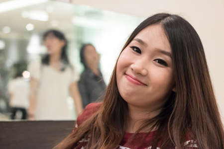 Close up of pretty Asian girl in the departent store