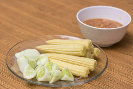 Vegetables and Shrimp-paste sauce on wooden background. Stock Photo