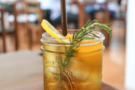 Glass of Peach tea in the cafe Stock Photo
