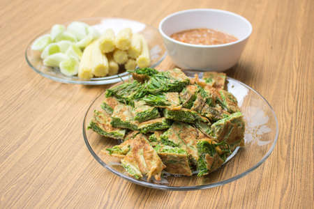 Thai food, Acacia Pennata Omelette and Shrimp-paste sauce, vegetables on wooden table background Stock Photo