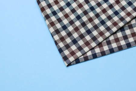 Kitchen napkin on blue background Stock Photo
