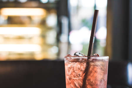 Glass of iced berry soda with blur background