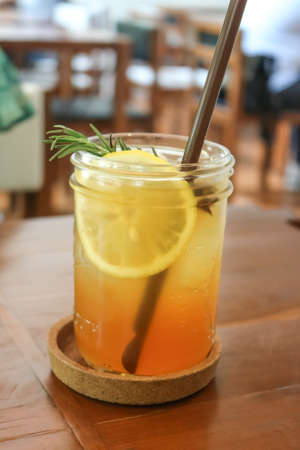 Glass of Peach tea in the cafe.