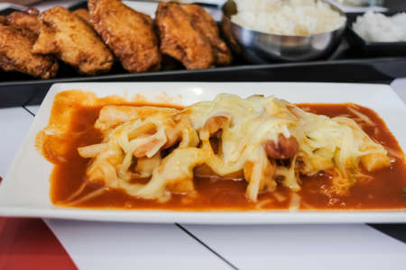 Korean food, Tteok-bokki with cheese in the restaurant. (Tteok-bokki or stir-fried rice cakes)