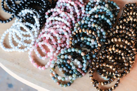 Close up of gemstone bracelets in the street market. Stock Photo
