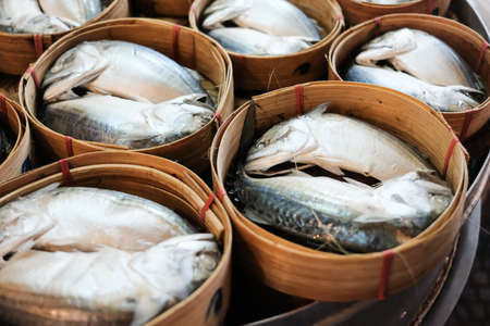 Close up of Mackerel fish in wooden basket.