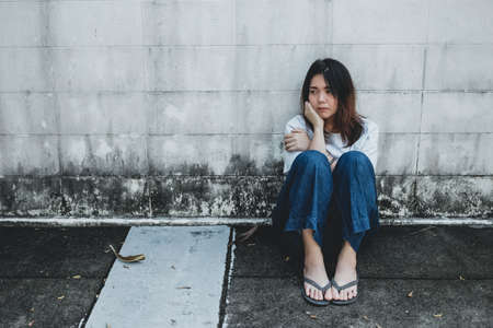 Young Asian girl sitting on the stressed and feeling depressed.