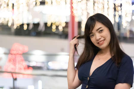 Beautiful Asian woman smiling with bokeh background.