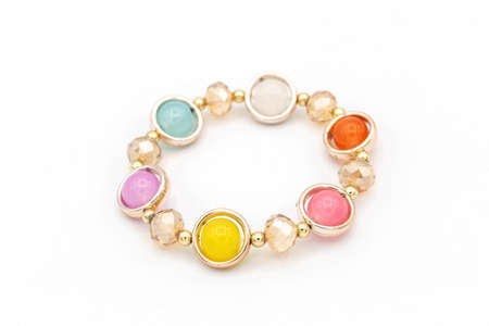 Colorful beads bracelet on white isolated background.