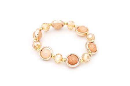 Pink beads bracelet on white isolated background.