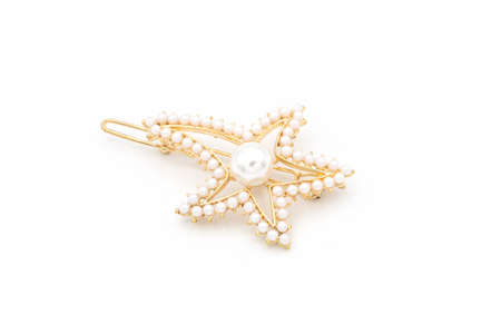 Luxury star shape hair clip on white isolated background.