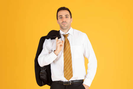 Portrait of confident businessman on yellow  background.
