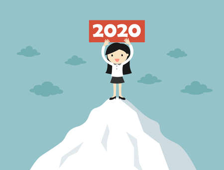 Business concept, Business woman is standing on the mountain holding