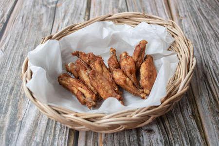 Crispy fried chicken wings in the basket.
