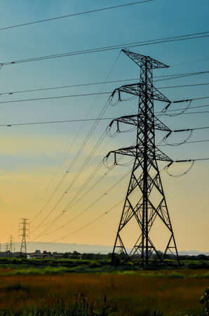 High voltage power pylons at sunset, Thailand photo
