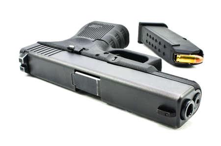 black handguns and  magazine on white background