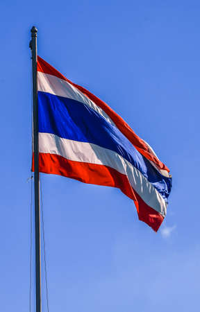 Flag of Thailand atop a background blue sky  photo
