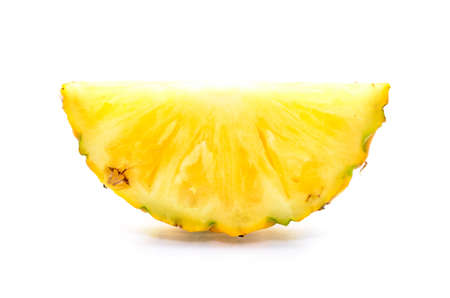Cross Section of a pineapple on white background   photo